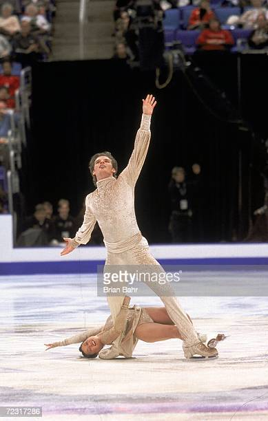 Koyoko Ina and John Zimmerman come in First in the Pairs Event during the 2000 State Farm US Figure Skating Championships at the Gund Arena in...