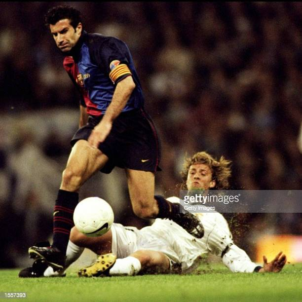 Luis Figo of Barcelona leaves Guti of Real Madrid in his wake during the Spanish Primera Liga match played at the Bernabeau Stadium in Madrid Spain...