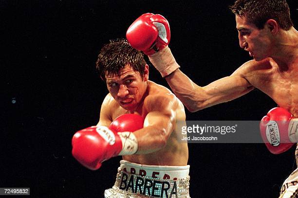 Marco Barrera makes a left swing during the WBC/WBO Super Bantamwight Championship against Erik Morales in Las Vegas Nevada Morales won by a decision...