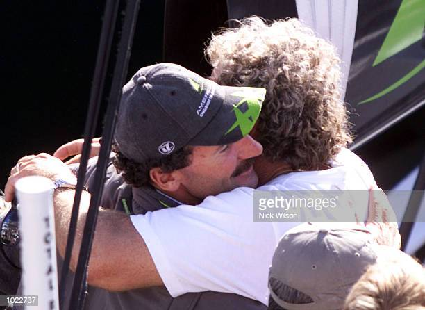 Paul Cayard of AmericaOne is huged by a teammate after Prada won the Louis Vuitton Cup after beating AmericaOne in the last race of the Louis Vuitton...