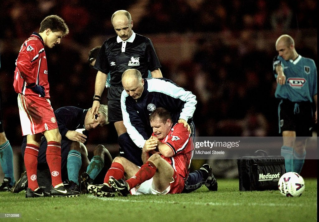 Paul Gascoigne of Middlesbrough is injured during the FA
