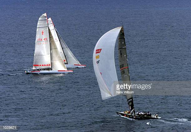 Prada and Team New Zealand sail close to one another during practise for the America's Cup starting Feb 19th on the Hauraki Gulf Auckland New...