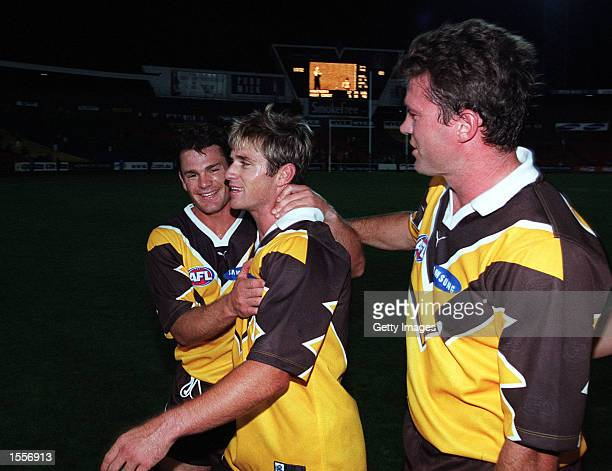 Richard Taylor for Hawthorn celebrates with temates Shane Crawford#9 and Barry Young during the match between Hawthorn and the West Coast Eagles in...
