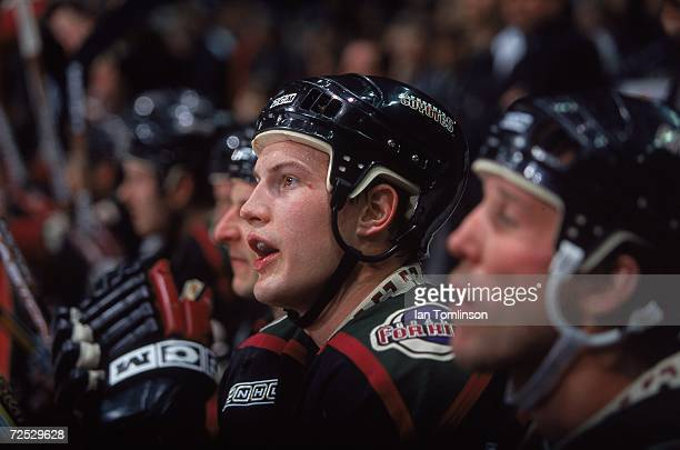 Shane Doan of the Phoenix Coyotes watches from the bench during the game against the Calgary Flames at the Canadian Airlines Saddledome in Calgary...