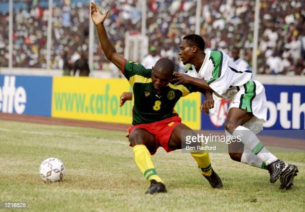 Sorelle Geremi of Cameroon holds off Celestine Babayaro of Nigeria during the African Nations Cup Final at the National Stadium in Lagos, Nigeria....