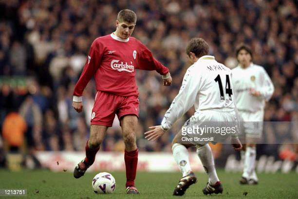 Steven Gerrard of Liverpool is challenged by Stephen McPhail of Leeds during the FA Carling Premiership match played at Anfield in Liverpool England...