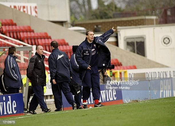 Swindon Town manager Jimmy Quinn passes on instructions during the Nationwide Division Two match against Grimsby Town played at the County Ground in...