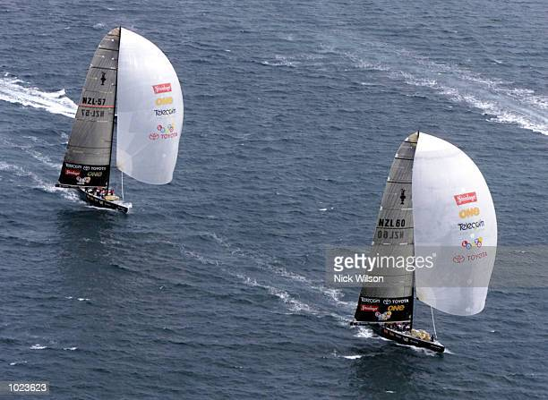 Team New Zealand race their black boats against each other during practice for the America's Cup starting Feb 19th on the Hauraki Gulf Auckland New...