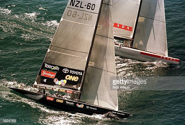 Team New Zealand's 'Black Magic' and Prada's 'Luna Rossa' race to the first mark during race one of the best of nine Americas Cup Finals Series on...