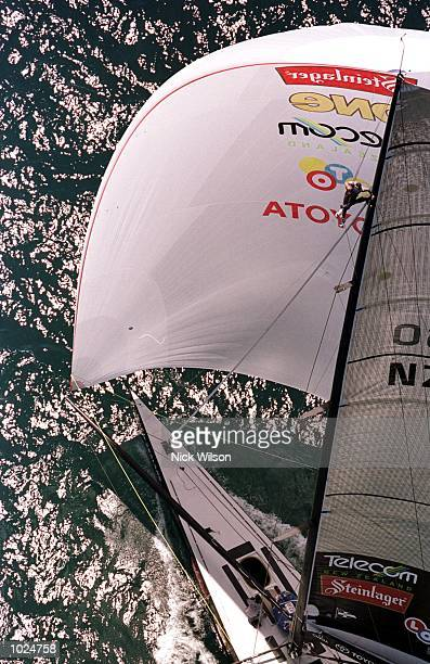 Team New Zealand's 'Black Magic' head down wind against Prada's 'Luna Rossa' during race one of the best of nine Americas Cup Finals Series on...