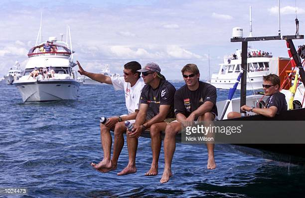 Team New Zealand's 'Black Magic' sit off the stern as they look on as a lack of wind forces the first race of the Americas Cup Finals to be postponed...