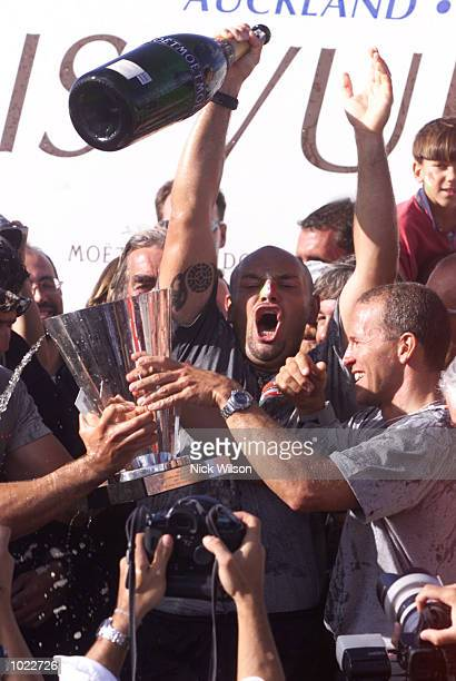 The crew of Prada celebrate winning the Louis Vuitton Cup after beating AmericaOne in the last race of the Louis Vuitton Finals on the Hauraki...