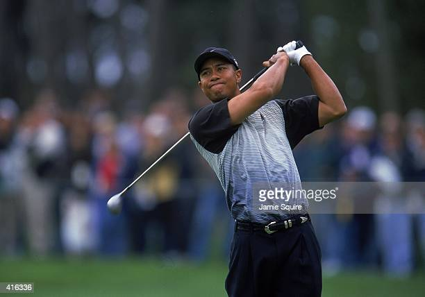 Tiger Woods follows his swing during the AT&T Pebble Beach Pro - AM at Poppy Hills Golf Course in Pebble Beach, California.. Mandatory Credit: Jamie...