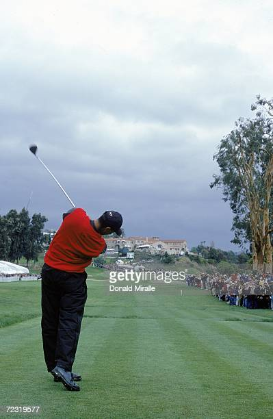 Tiger Woods makes a line drive to hole during the Nissan Open at the Riviera Country Club in Pacific Palisades, California. Mandatory Credit: Donald...