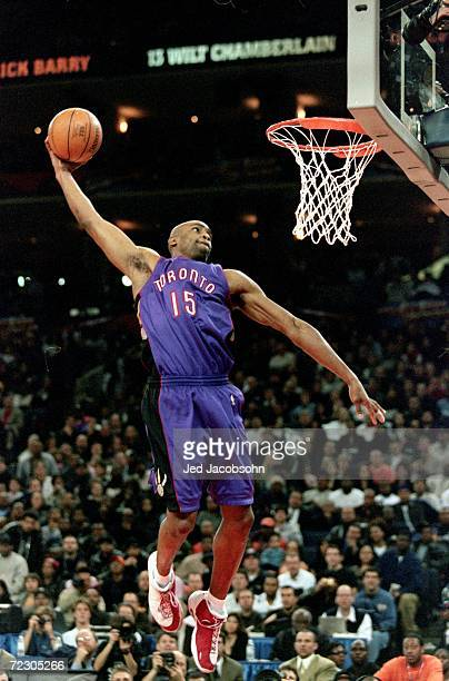 Vince Carter of the Toronto Raptors jumps to make the slam dunk during the NBA Allstar Game Slam Dunk Contest at the Oakland Coliseum in Oakland,...