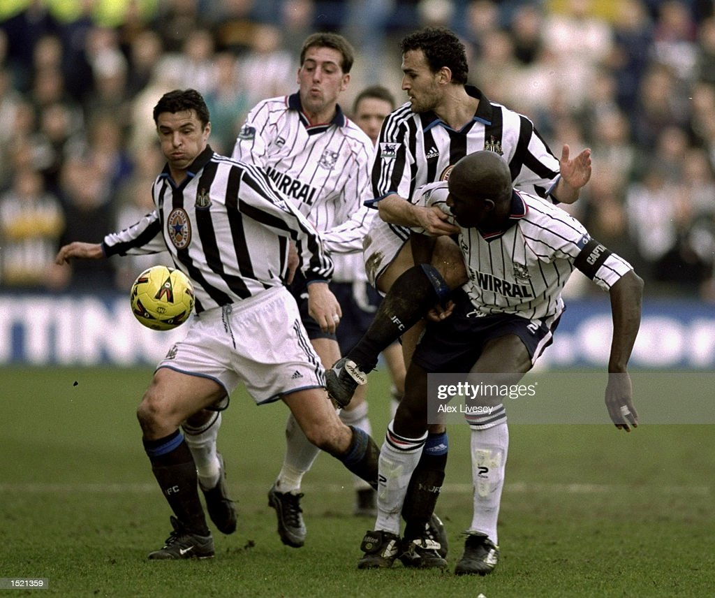 Wayne Allison of Tranmere Rovers battles with Gary Speed and Nicos Dabizas of Newcastle United during the AXA Sponsored FA cup sixth round game between Tranmere Rovers and Newcastle United at Prenton Park in Tranmere, England. \ Mandatory Credit: Alex Livesey /Allsport