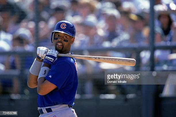Willie Greene of the Chicago Cubs looks on while at bat during the Spring Training Game against the Oakland Athletics at the Phoenix Minicipal...