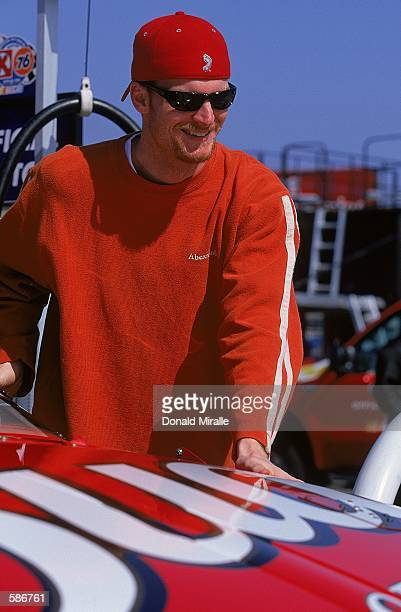 A close up of Dale Earnhardt Jr who drives the Chevy Monte Carlo for Dale Earnhardt Inc as he looks on during the Duralube 400 part of the NASCAR...