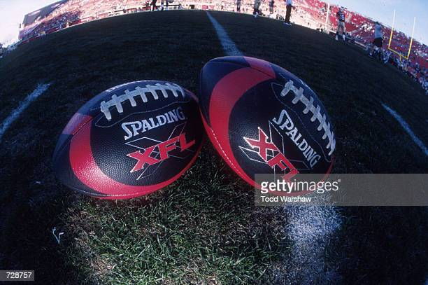 A couple of XFL footballs on display on the field during the game between the New York/New Jersey Hitmen and the Las Vegas Outlaws at Sam Boyd...