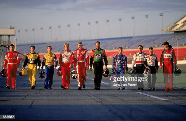 A view of Dodge Team Drivers as they walk on the track taken before the Daytona 500 Speedweeks at the Daytona International Speedway in Daytona Beach...