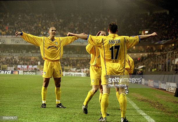 Alan Smith of Leeds United celebrates with teammates during the UEFA Champions League Group D match against Anderlecht played at the Stade Vanden...