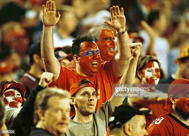An unidentified Orlando Rage fan cheers following the Rage's first touchdown against the Birmingham Bolts at the Florida Citrus Bowl in Orlando...
