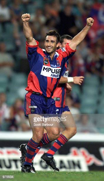 Andrew Johns of the Knights celebrates after kicking a field goal during the round 2 NRL match between the Sydney Roosters and Newscastle Knights...