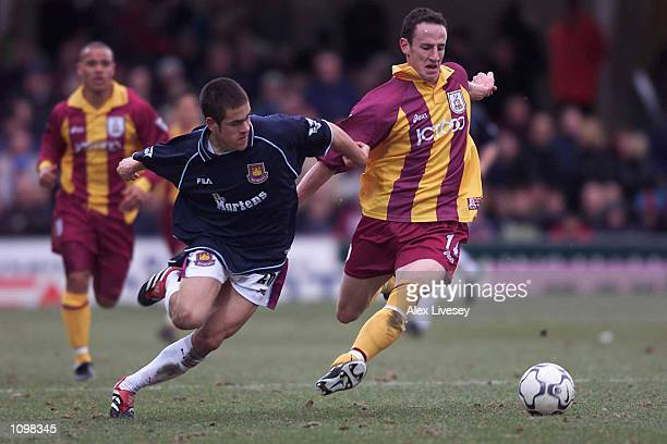 Andrew O''Brien of Bradford holds off Joe Cole of West Ham during the Premier League match between Bradford City and West Ham United at Valley...