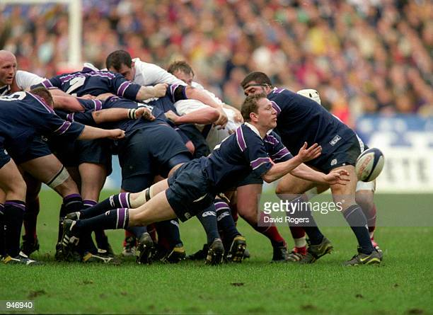 Andy Nicol of Scotland passes the ball during the Lloyds TSB Six Nations Championship 2001 match against France played at the Stade De France in...