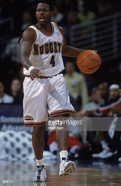 Anthony Goldwire of the Denver Nuggets dribbles the ball during the game against the New York Knicks at the Pepsi Center in Denver, Colorado. The...