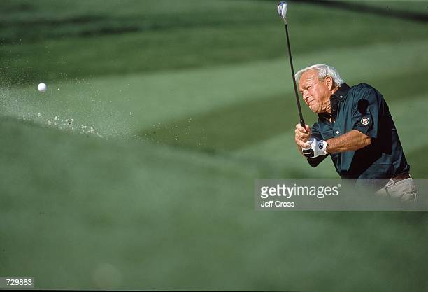 Arnold Palmer chips the ball during the Bob Hope Chrysler Classic at the Indian Wells Country Club in Indian Wells CaliforniaMandatory Credit Jeff...