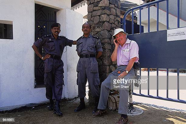 BBC Cricket Producer Peter Baxter is watched by two guards after a contract disagreement stops the BBC entering the ground during the first test...