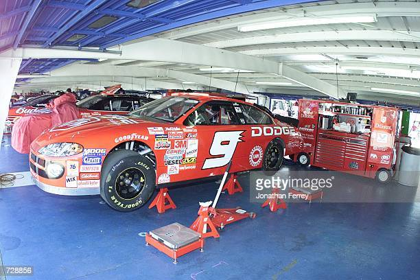 Bill Elliott's Evernham Motorsports Dodge Dealers Dodge Intrepid R/T waits in the garage for the start of the NASCAR Winston Cup Daytona Speedweeks...