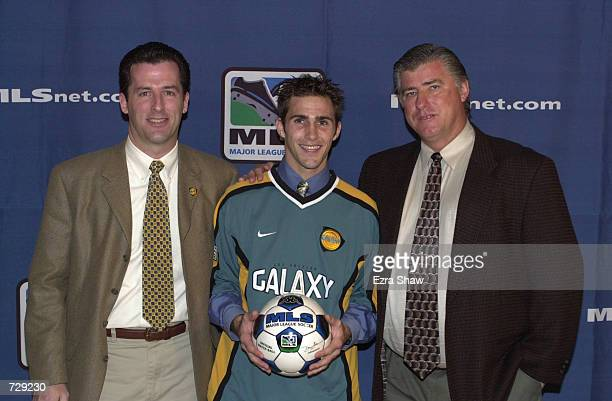 Brian Mullan poses with Los Angeles Galaxy general manager Tim Luce and coach Sigi Schmid during the Major League Soccer Super Draft at the Signature...