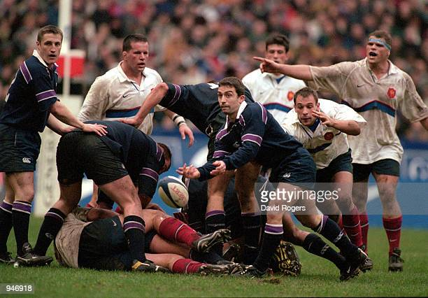 Bryan Redpath of Scotland passes the ball during the Lloyds TSB Six Nations Championship 2001 match against France played at the Stade De France in...