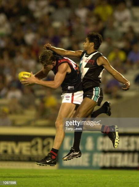 Che CockatooCollins for Port Adelaide tries to spoil Danny Jacobs for Essendon in the match between Port Power and the Essendon bombers played at...
