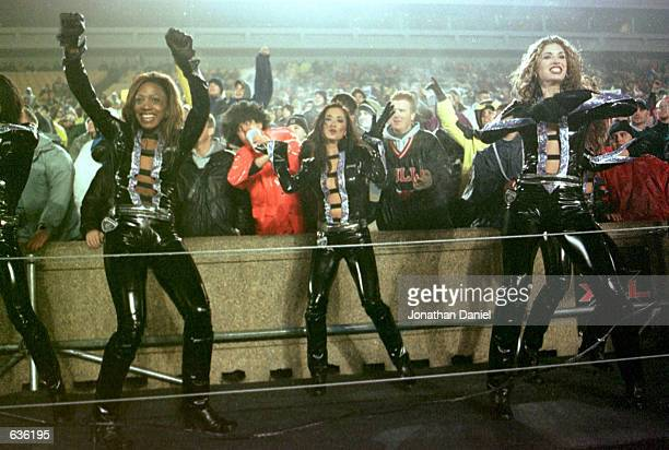 Chicago Enforcers cheerleaders entertain the crowd and television cameras at a game vs the NY/NJ Hitmen at Soldier Field in Chicago Illinois The...