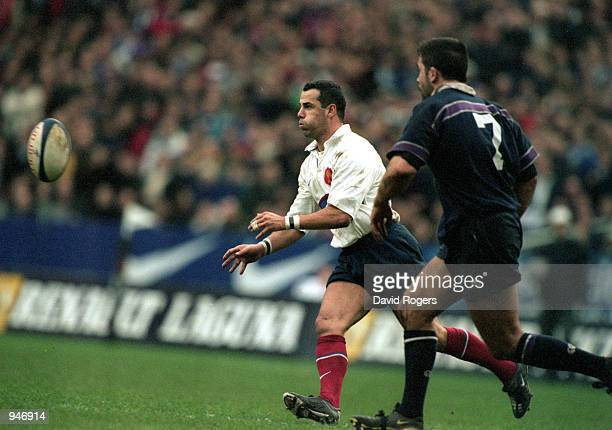 Christophe Lamaison of France passes the ball during the Lloyds TSB Six Nations Championship 2001 match against Scotland played at the Stade De...