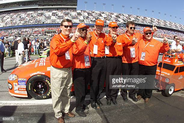 Chrysler Group President and CEO Dieter Zetsche and COO Wolfgang Bernhard pose with executives from UAW GM on the grid before the NASCAR Winston Cup...