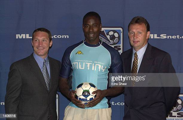 Craig Demmin center the sixth pick overall in the Major League Soccer Super Draft by the Tampa Bay Mutiny poses with Mutiny general manager Bill...