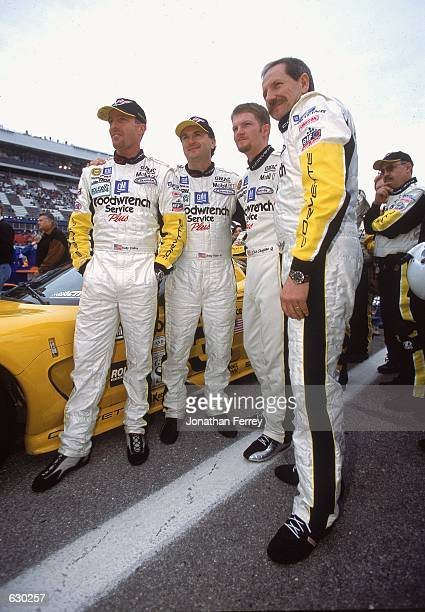 Dale Earnhardt Dale Earnhardt Jr Andy Pilgrim Kelly Collins pose for a photo during the Rolex 24 Hours of Daytona at the International Speedway in...