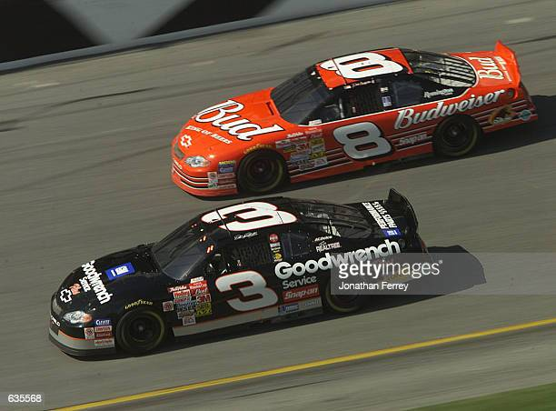 Dale Earnhardt in the GM Goodwrench Chevrolet dices with his son Dale Earnhardt Jr in the Budweiser Chevrolet during the NASCAR Winston Cup Daytona...