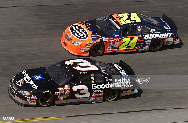 Dale Earnhardt in the GM Goodwrench Chevrolet dices with Jeff Gordon in the DuPont Chevrolet during the NASCAR Winston Cup Daytona 500 at the Daytona...