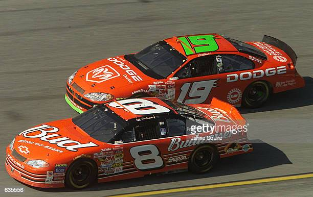 Dale Earnhardt Jr in the Budweiser Chevrolet dices with the Evernham Motorsports Dodge Dealers Dodge Intrepid of Casey Atwood during the NASCAR...