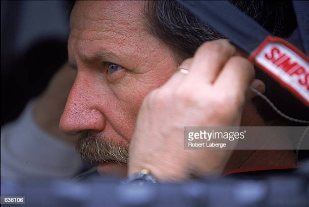 Dale Earnhardt who drives the Chevy Monte Carlo for Richard Childress Racing pulls his helmet on before the Daytona 500 Speedweeks part of the NASCAR...