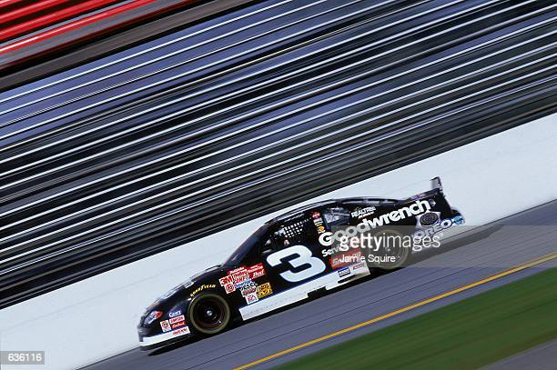 Dale Earnhardt who drives the Chevy Monte Carlo for Richard Childress Racing pulls out of a turn during the Daytona 500 Speedweeks part of the NASCAR...