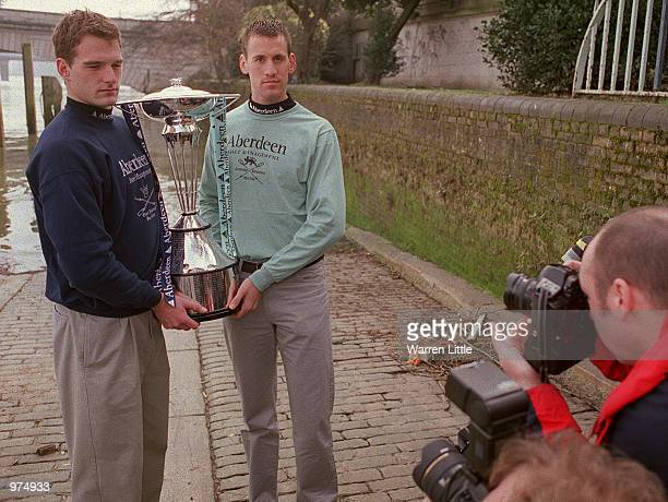 Dan Snow President of Oxford University and Kieran West the President of Cambridge University seen holding the cup during the President's Challenge...