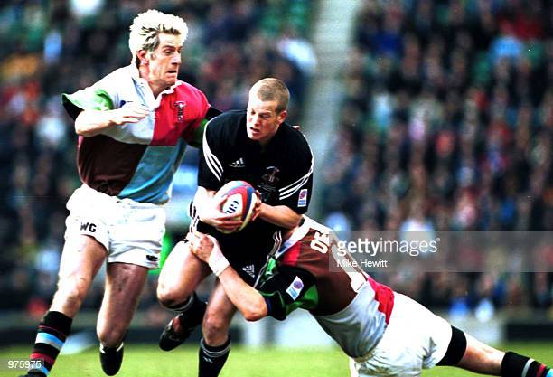 Dave Walder of Newcastle is stopped by Ryan O''Neill and Will Greenwood of Quins during the match between NEC Harlequins and Newcastle Falcons in the...