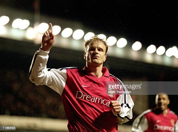 Dennis Bergkamp of Arsenal celebrates opening the scoring during the UEFA Champions League Group C match against Lyon played at Highbury in London...