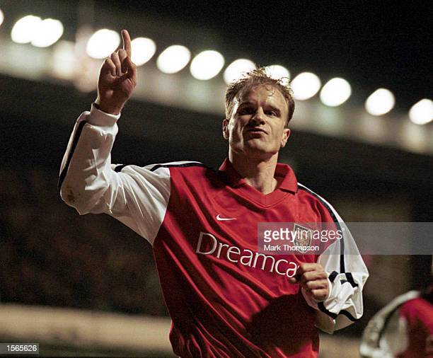 Dennis Bergkamp of Arsenal celebrates scoring the first goal during the UEFA Champions League match between Arsenal and Olympique Lyonnais at...